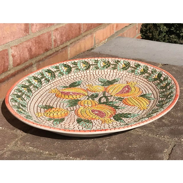 Beautiful over-sized ceramic serving platter hand made in Italy for Neiman Marcus. Lovely spring color palette made to...