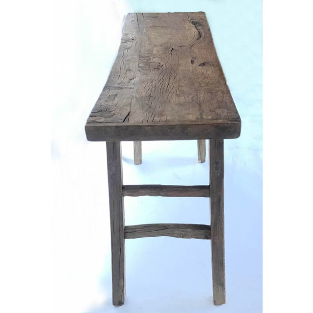 Antique elm wood altar table with unusual curved stretchers and mortise and tenon construction. Smooth, naturally worn...
