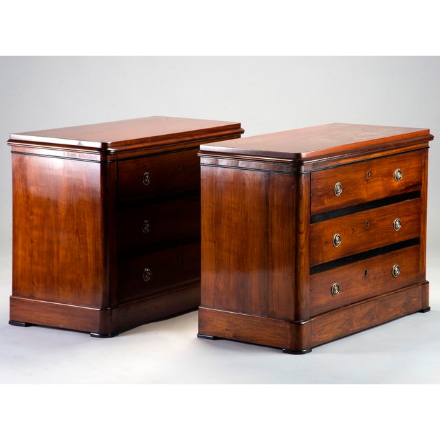 Circa 1940s pair of three drawer English mahogany chests with nicely figured wood and black detailing at the edges....
