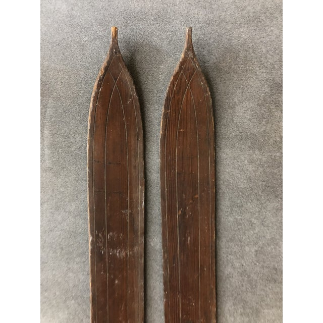 """Vintage Wood Skis. Solid wood; likely hickory. Nice carved skis. Has sticker remnants marked """"Northland Skis"""". One..."""