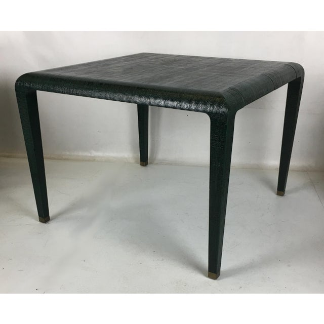 Superbly crafted games table clad in lacquered Raffia with two pencil drawers on one side. The tapered square legs...