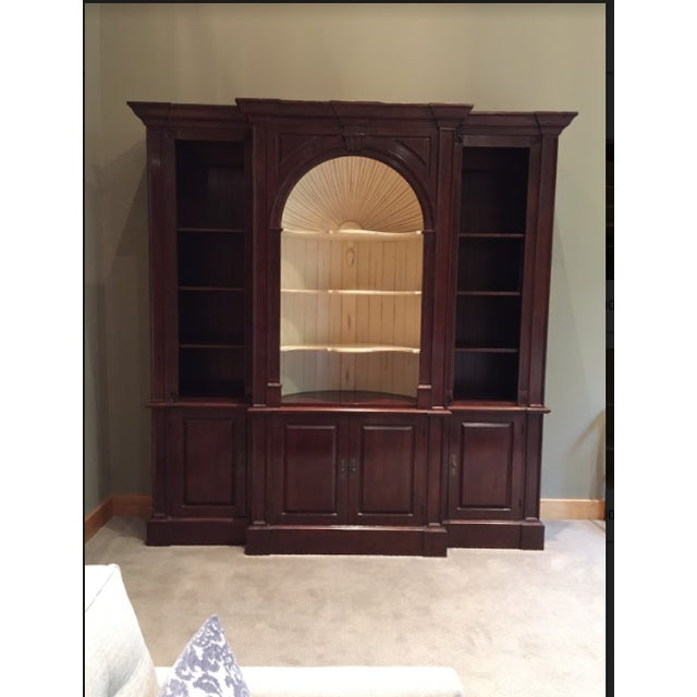This solid cherry wall cabinet was special ordered with beautiful Harden custom hand stained finishes. The hand carved...