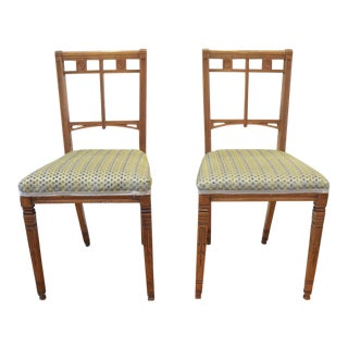 A PAIR OF AESTHETIC MOVEMENT CHAIRS