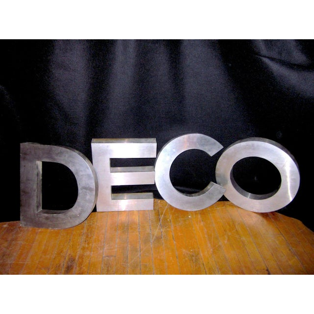 This is a set of four stainless steel letters, perfect for display, interior or exterior signage, or for use in a home...
