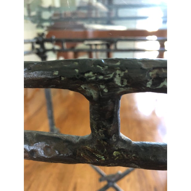 Wonderful Giacometti style table having an earthy cast aluminum base with a brown aged textural patina, handsome...