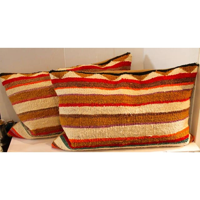 This is a vibrant yet simple striped pattern Indian weaving saddle blanket pillows. Sold as a pair. Great condition.