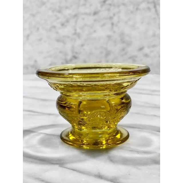 A Pair of Victorian Pressed Amber Glass Candlestick Holders, United States, c. Mid 20th Century. This Pair would look...