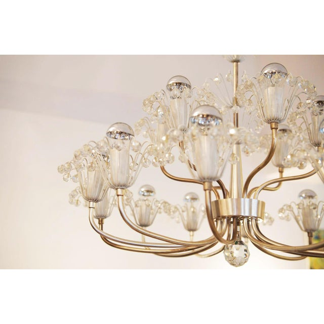 This large chandelier was designed during the 1960s by Emil Stejnar for Rupert Nikoll in Austria. It features a nickel-...