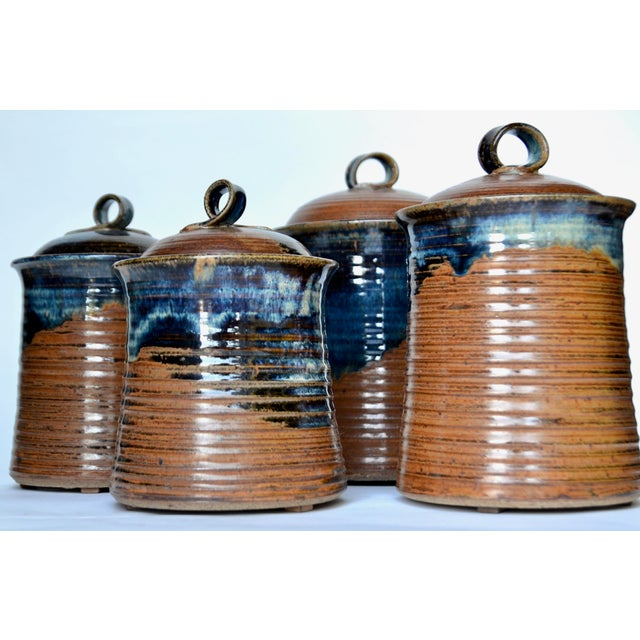 Artistic stoneware canister set of four glazed containers. Enrich your kitchen counter with fantastic Mid Century styling...