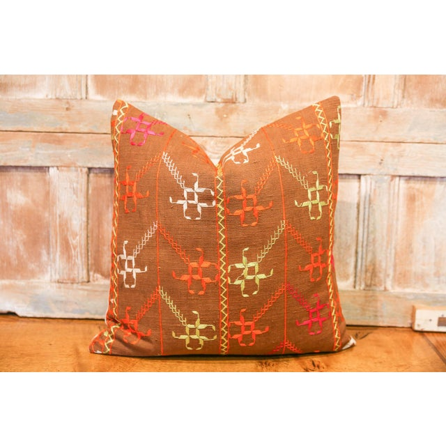 The colorful and luxurious Bagh Phulkari features beautiful hand-done silk embroidery on top of a brown cotton fabric....