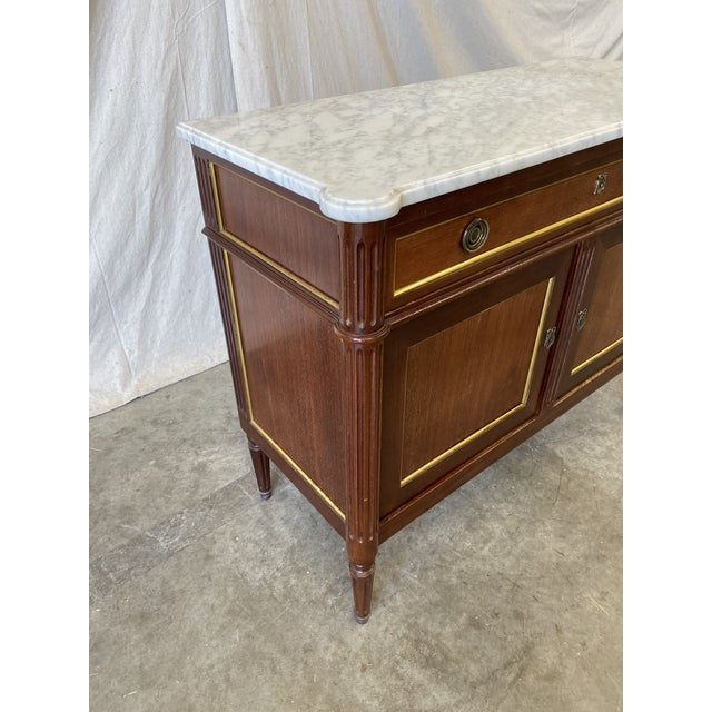 Classic Italian marble top walnut buffet, with working keys. This piece is timeless in design, with tailored lines, and...