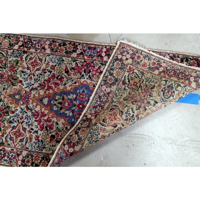 Antique handmade Persian Kerman rug in colourful shades. It is from the beginning of 20th century in original good condition.