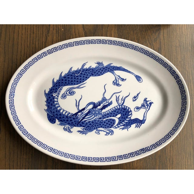 A pair of matching plates from Double Phoenix, Nikko Stoneware The plates are oval shaped. White with blue dragon and a...