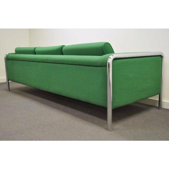 Unique, Vintage, Mid Century Modern 3 Seater Tubular Chrome Frame Sofa after Milo Baughman. Sofa features a great...