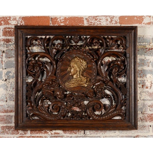Stunning and ornate Rococo wall panel featuring highly carved details and figural heads. Wooden designs surround a central...
