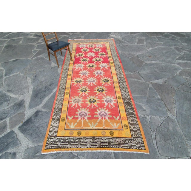 Hand-knotted with the finest details including delicate flowers within geometric motifs, this rug is a must for any avid...