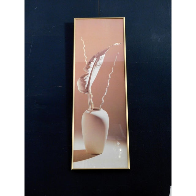 This poster of an elegant vase with subtle hues of pinkish tones features a Brass frame. Great for an entryway or on a...