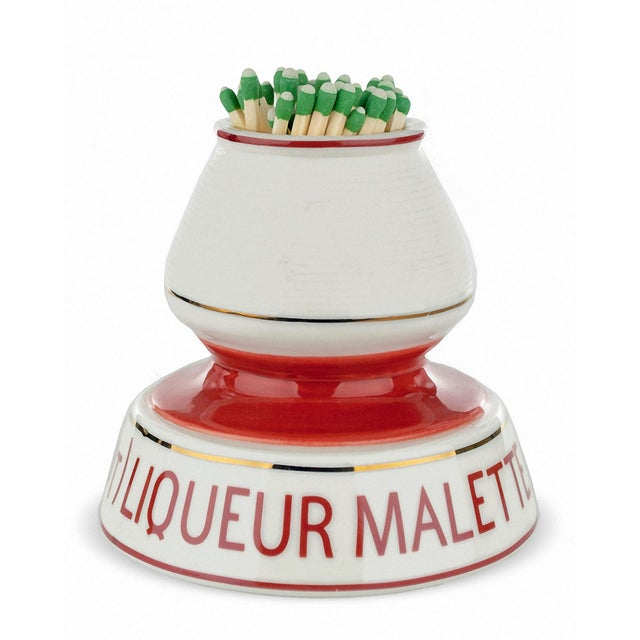 """A French Bistro match striker and holder advertising """"Liquer Malette"""". A nice touch near the fireplace, cook top or..."""
