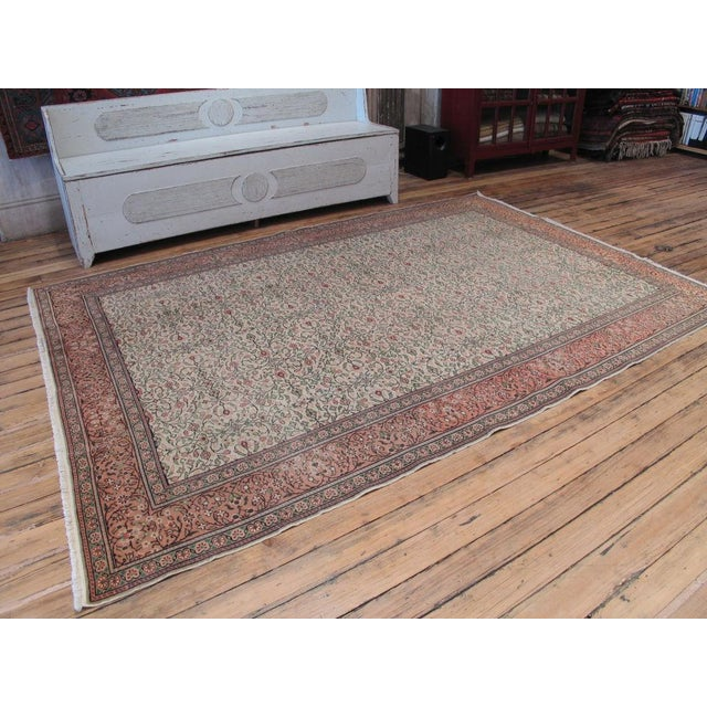 An elegant vintage Turkish rug featuring a classically inspired design.