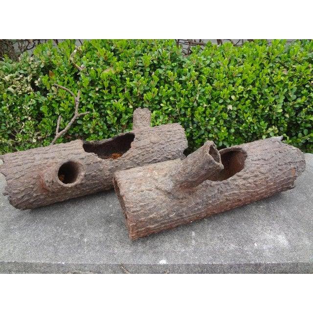 Unusual vintage pair of faux bois iron log planters or sculptures. This unique pair of faux bois figures would look great...