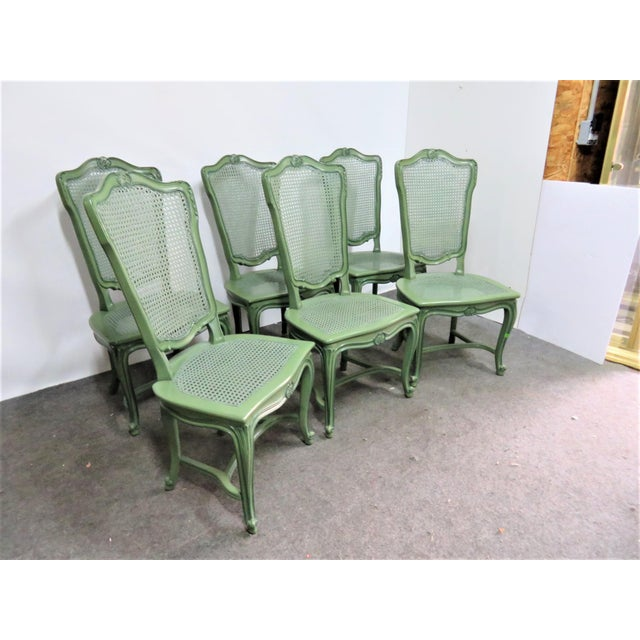 Set of 6 Louis XV style dining chairs, caned seats and backs, custom tri color green painted finish.