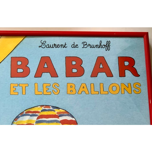 Lovely French children's art of the beloved Babar flying above his village in a hot air balloon with many friends....