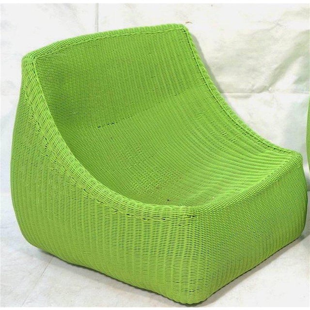 """Pair of woven fiberglass lime green lounge chairs, each one luxurious continuous woven """"scoop"""" lounge, comfortable without..."""