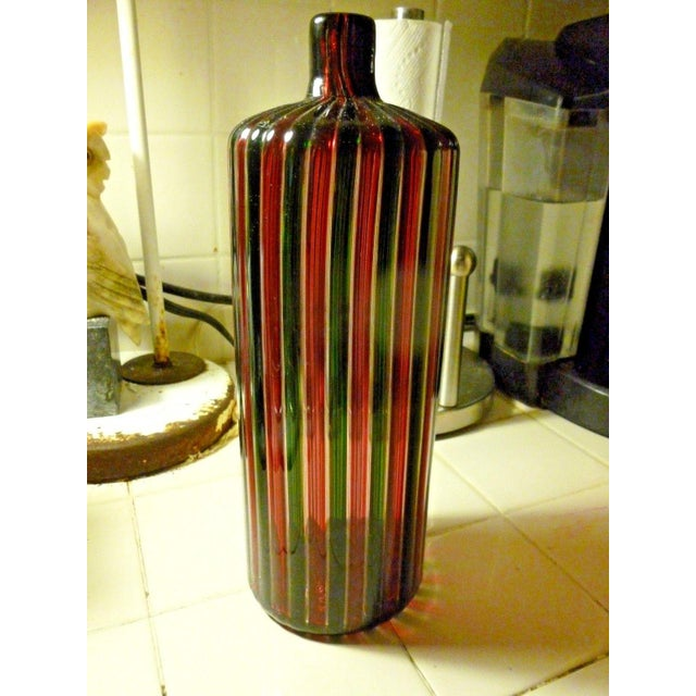 Large Italian Murano signed Venini multi striped bottle marked Venini measuring 11 inches tall sold as found in good...