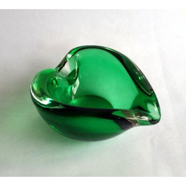 This item is a piece of glass art in the shape of a curled leaf. This elegant piece can used an ashtray, candy dish or...