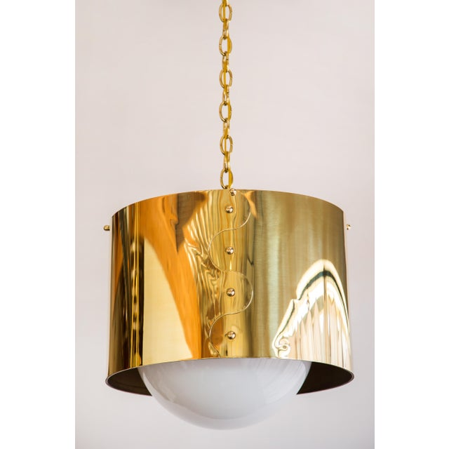 Pair of mid-century brass drum shaded pendants. These have been restored with new brass, electrical and globes. Since...