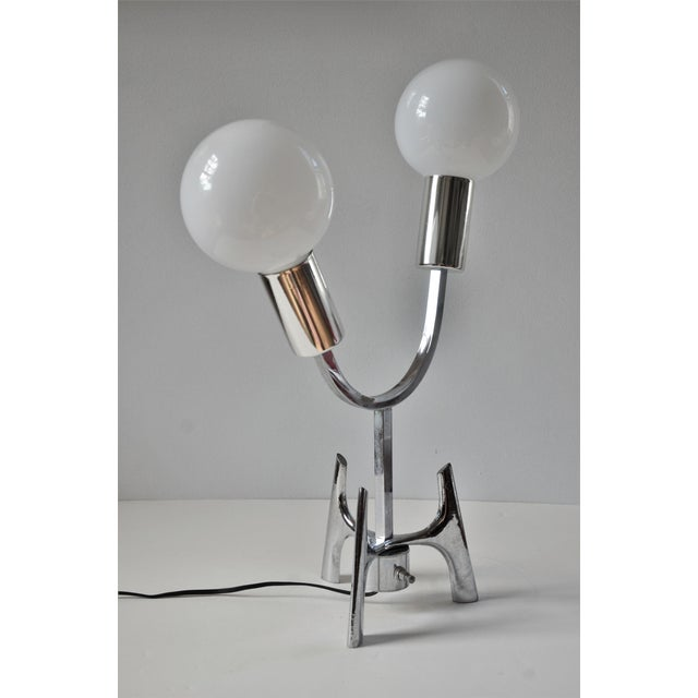 A vintage atomic space age Mid-Century Modern chrome table lamp. Heavy solid metal construction, very cool design with a...