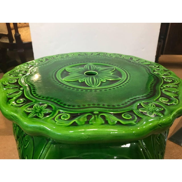 A vibrant green Majolica garden seat, made by Minton, year mark 1897. Designed by Augustus Welby Pugin, hexagonal...