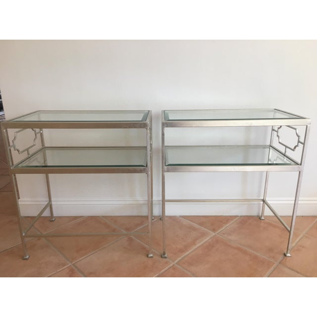Hardly used, beautiful glass side tables. Neoclassical influence is present in this two-shelf table, dressed in silver...