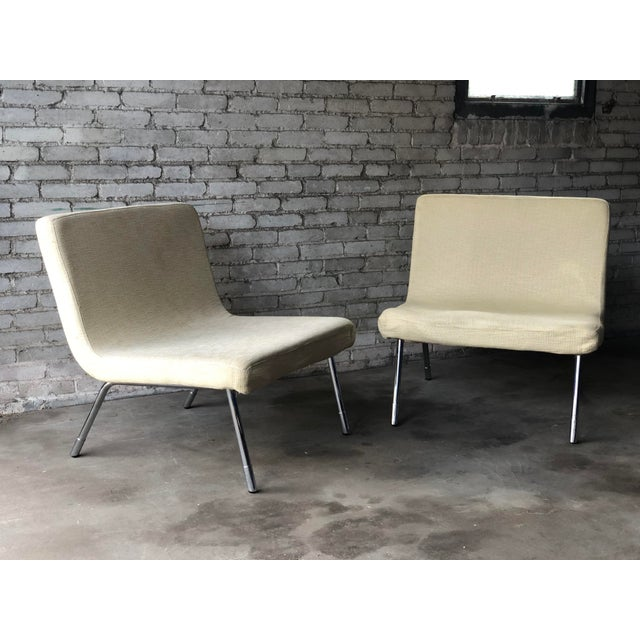Pair of Roche Bobois Lounge Chairs, circa 1990s. Ultra wide and deep seating lounge chairs upholstered in light creme...