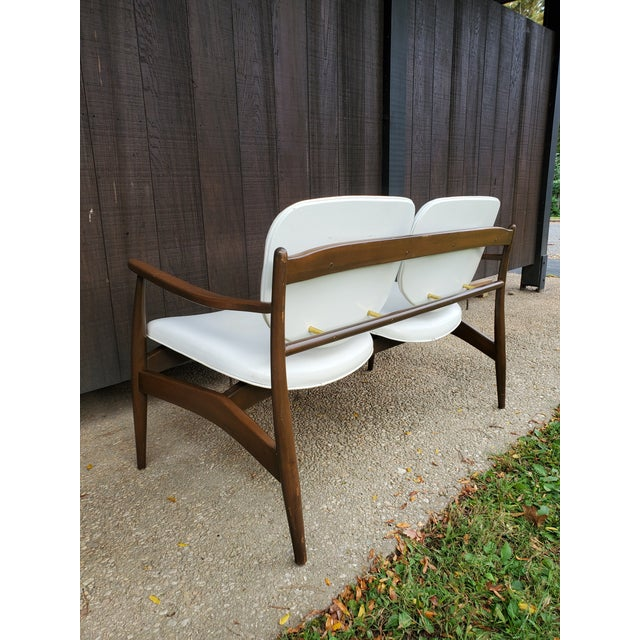 Incredible mid-century modern settee, Danish in style but from our guesses it's American made. No makers mark or stamp but...