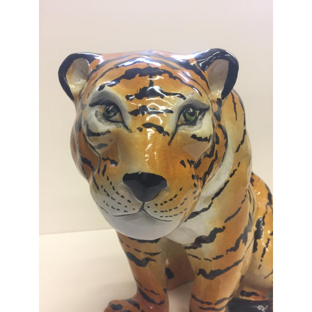 Handsome glazed terracotta sculpture of a seated tiger with beautiful coloring.