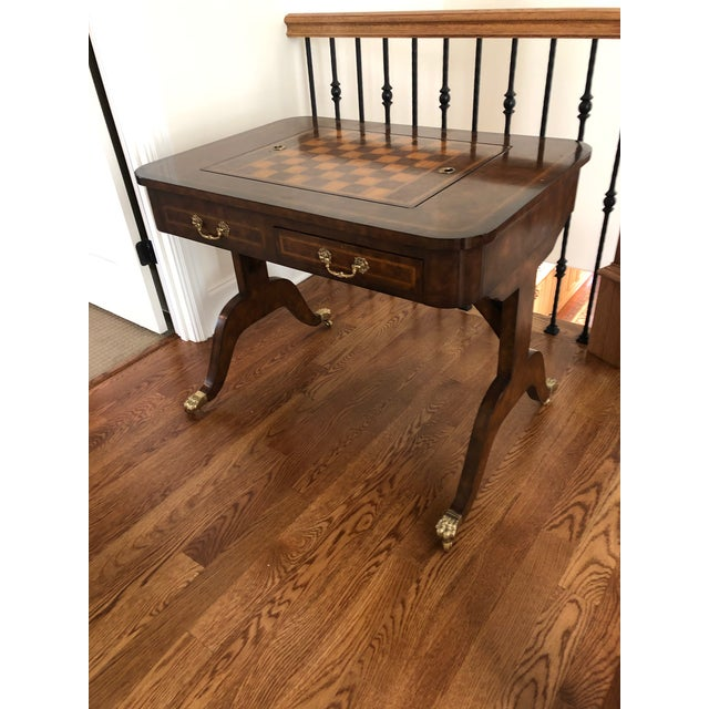 Authentic Maitland-Smith English Regency style game table. Burled walnut, double pedestal, parquetry inlaid on saber legs...