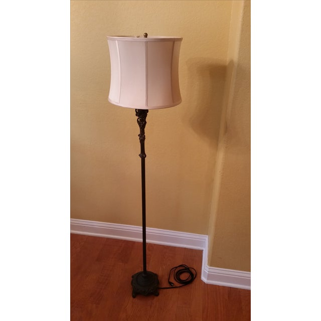 This bronze-finished cast iron floor lamp is a vintage piece from Ethan Allen. The custom silk shade is a soft champagne...