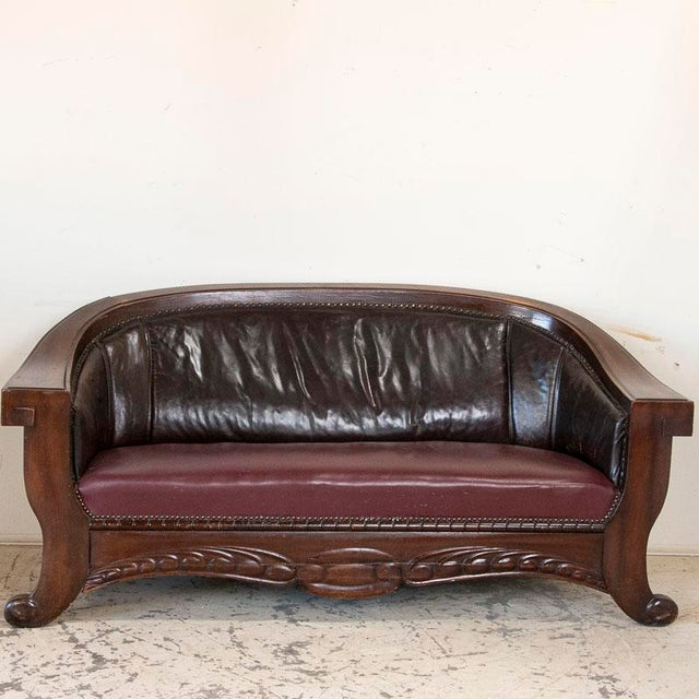 Remeniscent of a time when men would go to smoking lounges for private convesation, this set of vintage leather sofa and...