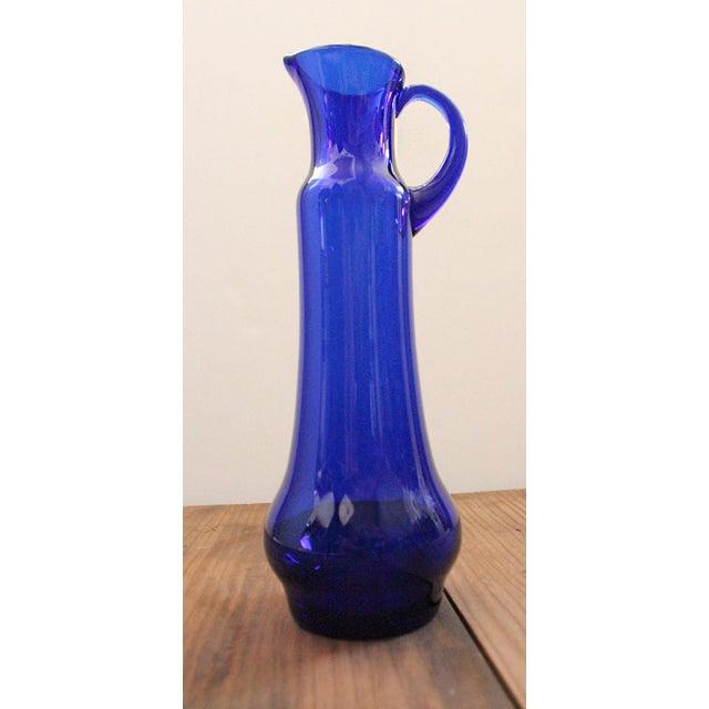 Vintage 1950s Wayne Husted for Blenko pitcher style vase in cobalt blue. Husted was Blenko's head designer from 1958 to...