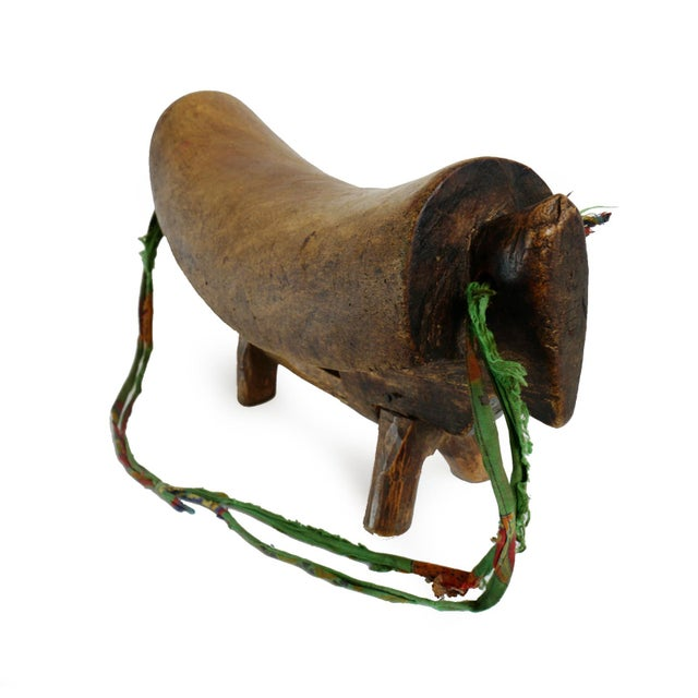 Authentic Dinka headrest from Eastern Sudan. Solid wood pillow used to keep head off the ground while sleeping. Striking...