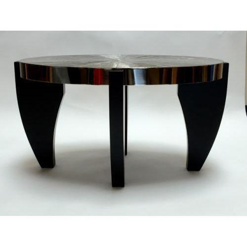The Arche occasional table by Christian Heckscher is hand made and shown with an acid etched nickel top with a four piece...