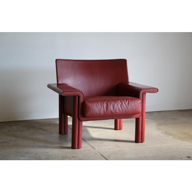 Large leather lounge chair by Afra and Tobia Scarpa for Meritalia. Unusual and sumptuous form. Stunning raspberry red...