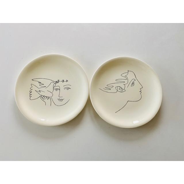 """Ceramic Plates designed by Pablo Picasso circa 1965 with tiltled """"La femme aux épis"""" linear woman portrait in black with a..."""
