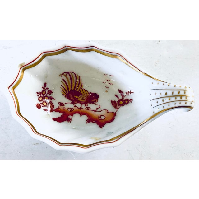 Charming pair of catchalls by the Italian designer Richard Ginori. Both are decorated in a chinoiserie pattern with red...