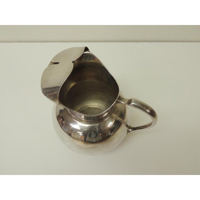 Polished Argentinian sterling silver water pitcher with handle. Size: 6 x 8 x 8.5 H.