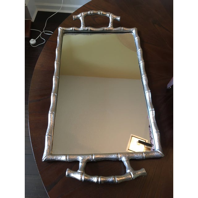 Beautiful bamboo design mirrored tray with handles. Velvet covering to prevent scratching surfaces. Nice, sturdy weight...