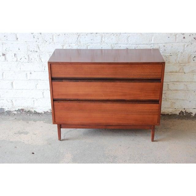 Offering a very nice Kipp Stewart for Calvin Furniture dresser chest. The chest has a nice ebonized sculpted pulls that...