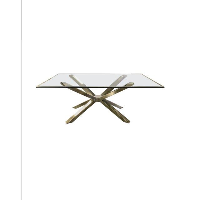 Exceptional mid century modern style glass dining table with a sculptural chrome base and four Calligaris matching chairs...