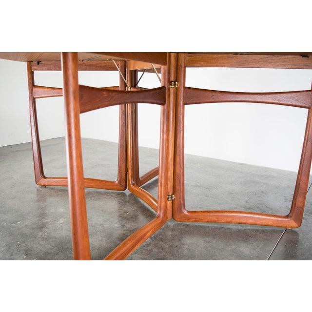 A spectacular, sculptural teak drop-leaf table, Model No. 20/59 designed by Peter Hvidt & Orla Molgaard-Nielsen, c. 1960,...